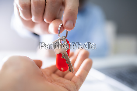 estate agent giving house keys to