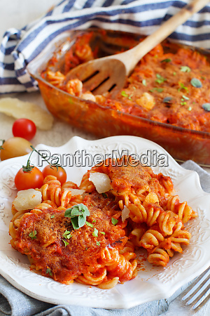 plate with baked pasta with tomato