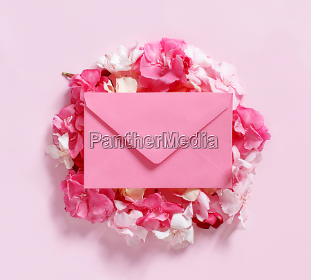 pink envelope on flowers over