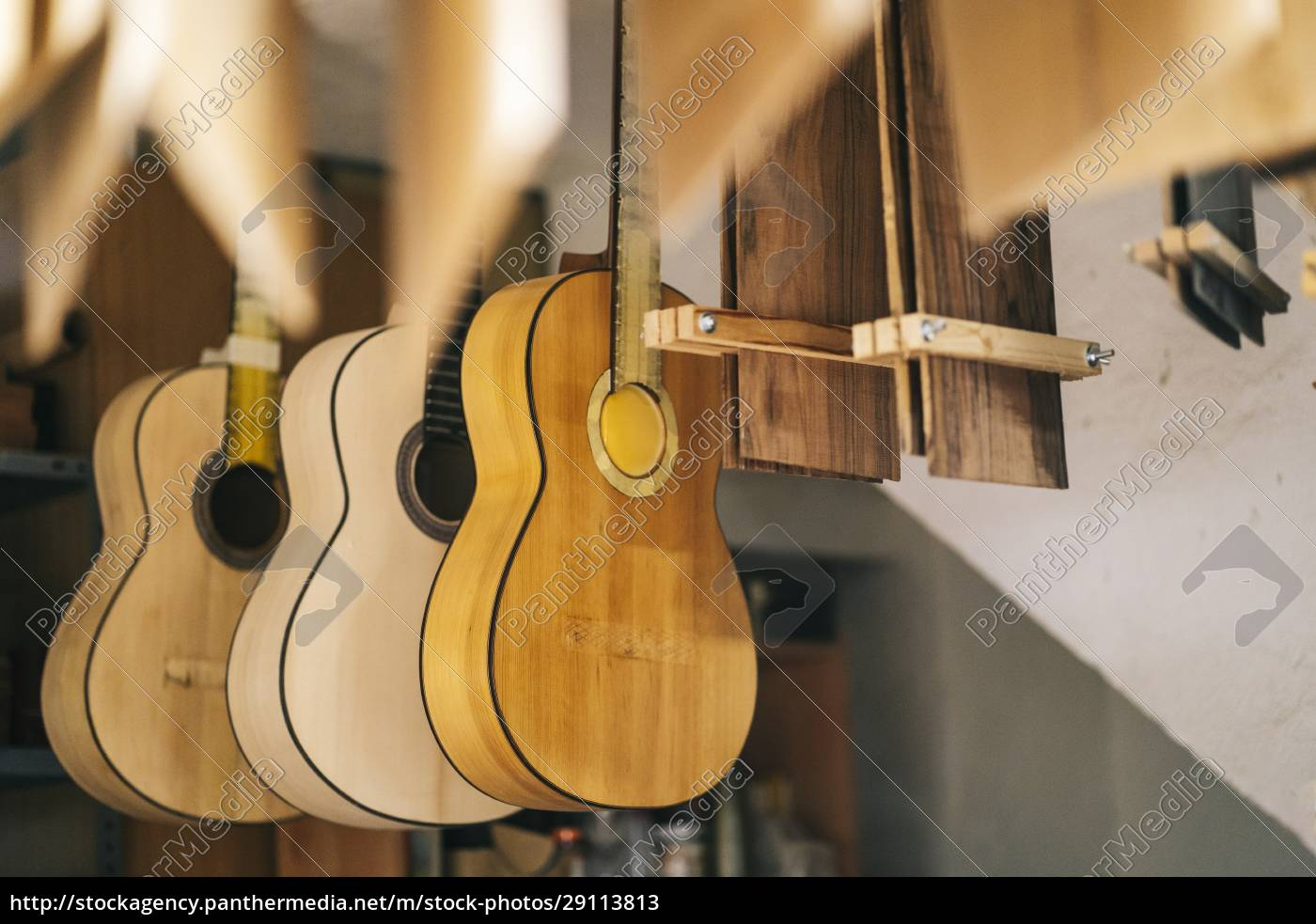 guitars, hanging, in, a, line, at - 29113813