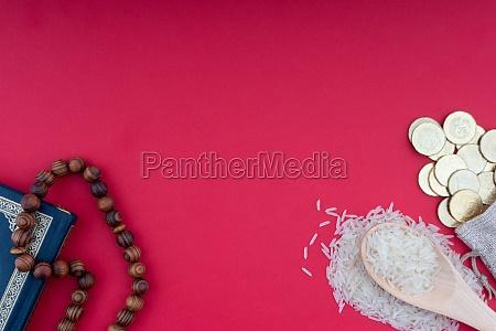 sagrado coran monedas rosario y arroz